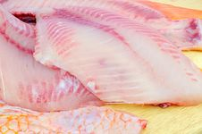 Free Red Tilapia On Chopping Block . Royalty Free Stock Image - 17218736