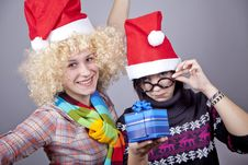 Free Two Beautiful Girls With Gifts In Christmas Hats Stock Images - 17220924