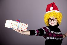 Funny Girl In Glasses With Christmas Gifts. Royalty Free Stock Images
