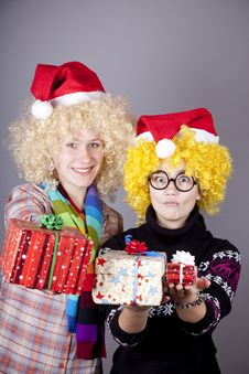 Free Two Beautiful Girls With Gifts In Christmas Hats Stock Photo - 17220970