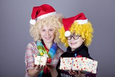 Free Two Beautiful Girls With Gifts In Christmas Hats Royalty Free Stock Photo - 17220985