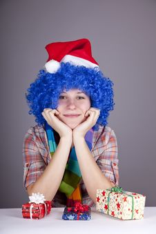 Funny Girl With Christmas Gift. Royalty Free Stock Photography