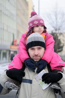 Free Young Father Gives His Daughter A Ride On His Back Royalty Free Stock Images - 17221239