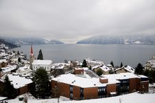Winter View Of Small Town And Mountain Lake Royalty Free Stock Photography