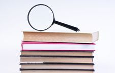 Book With Magnifying Glass Stock Photography