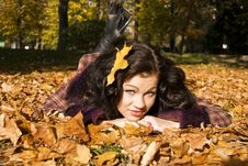 Free Pretty Girl Lays On The Fallen Leaves Royalty Free Stock Images - 17223769