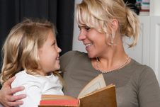 Mother Reading To Daughter Stock Image