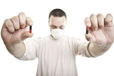 Free Man With Hospita Mask Holding Pills Royalty Free Stock Photography - 17224597
