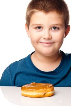 Free Boy And A Donut Royalty Free Stock Photos - 17225718