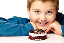 Free Young Boy Deciding To Eat Dessert Royalty Free Stock Photo - 17225725