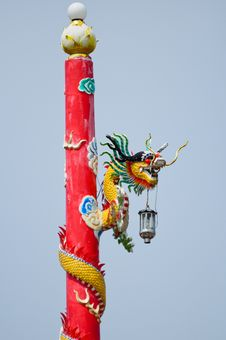 Dragon On Red Pole Stock Photo