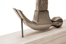 Free Hammer And Nail Isolated On Wood Brick Royalty Free Stock Photos - 17227658