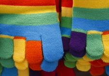 Free Knitted Striped Winter Gloves In Bright Colors Royalty Free Stock Images - 17230899