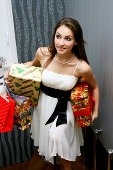 Free Beautiful Young Woman With Gifts Royalty Free Stock Images - 17231669