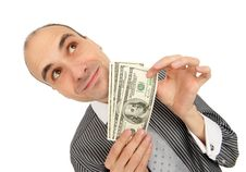 Free Businessman Holding Money Royalty Free Stock Photos - 17233358