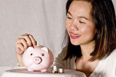 Free Young Woman With Pink Piggy Bank Stock Image - 17236111