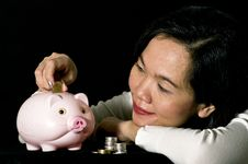 Free Young Woman With Pink Piggy Bank Royalty Free Stock Image - 17236606