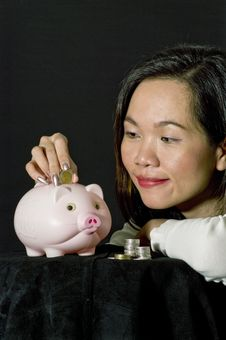 Free Young Woman With Pink Piggy Bank Royalty Free Stock Image - 17236816