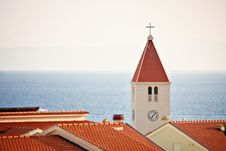 Free Chatolic Church Over Roofs At Sea. Stock Image - 17237031