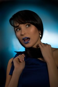 Beautiful Young Woman On The Blue Background Royalty Free Stock Images