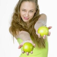 Woman With Apples Stock Images