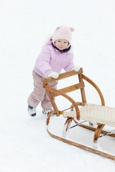 Free Girl With A Sledge Royalty Free Stock Photo - 17238135