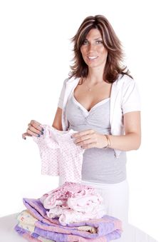 Free Folding Baby Clothes Royalty Free Stock Photography - 17239477