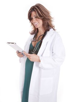 Pregnant Doctor Looking At Chart Royalty Free Stock Image