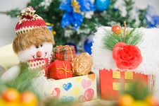 Greeting Santa With Gifts Front Of Christmas Tree Royalty Free Stock Photo