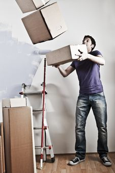 Free Man Carrying Stacked Boxes Royalty Free Stock Photography - 17245877