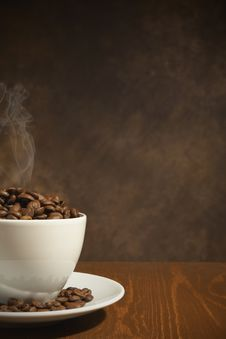 Free Cup Of Coffee, Full Of Beans Royalty Free Stock Photo - 17249075