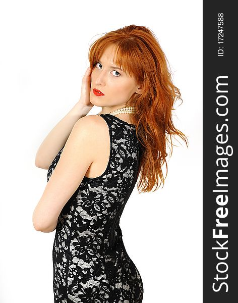 Beautiful red haired woman in lace black dress