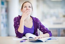 Pretty Female College Student In A Library Royalty Free Stock Photo