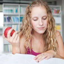 Free Pretty Female College Student In A Library Stock Photos - 17251293
