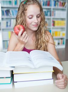 Free Pretty Female College Student In A Library Royalty Free Stock Image - 17251436