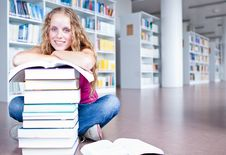Free Pretty Female College Student In A Library Stock Image - 17251971