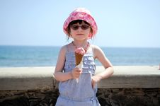 Free Small Girl In Glasess And Sun Hat With Ice Cream Royalty Free Stock Photography - 17251987