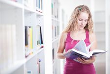Free Pretty Female College Student In A Library Royalty Free Stock Photo - 17252135