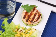Grilled Salmon And Zucchini With Salad Royalty Free Stock Photos
