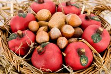 Apples And Nuts In A Basket Stock Image