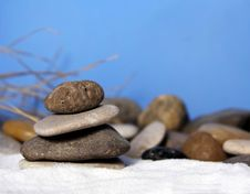 Free Stones On White Sand Royalty Free Stock Photo - 17255045