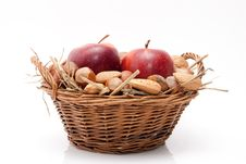 Free Nuts And Apples In A Basket Royalty Free Stock Image - 17255976