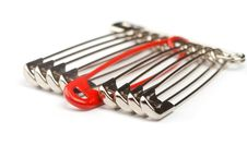 Free Safety Pins With One Red Royalty Free Stock Images - 17256899