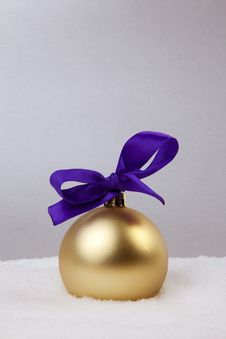 Christmas Golden Ball With Bow Royalty Free Stock Image