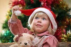 Free Small Girl With Toy Near Christmas Tree Stock Image - 17259981