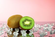 Kiwi And Pieces Of Ice Royalty Free Stock Photos