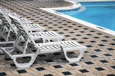 Deckchair By The Pool Royalty Free Stock Photography