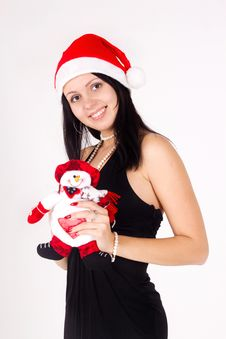 Santa Girl  Holding A Snowman. Royalty Free Stock Photos