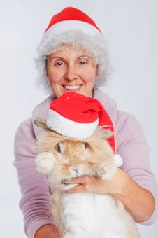 Free Woman In Santa Hat Holding Cute Rabbit. Stock Photo - 17266880