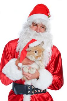 Photo Of Happy Santa Claus Holding A Cute Rabbit Stock Image